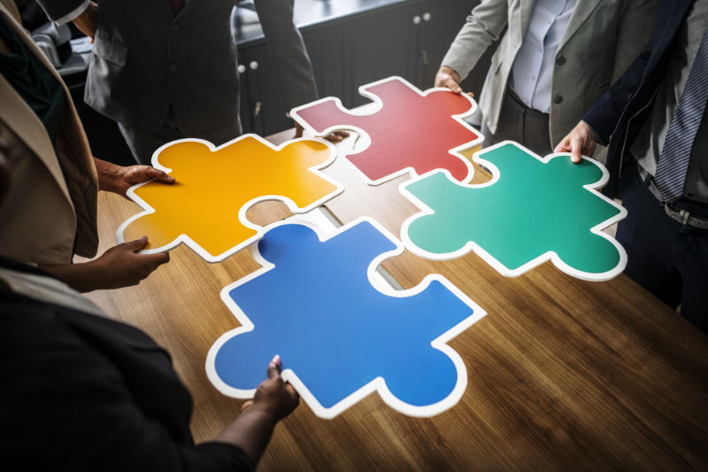 Business People Connecting Puzzle Pieces Ortsgemeinde